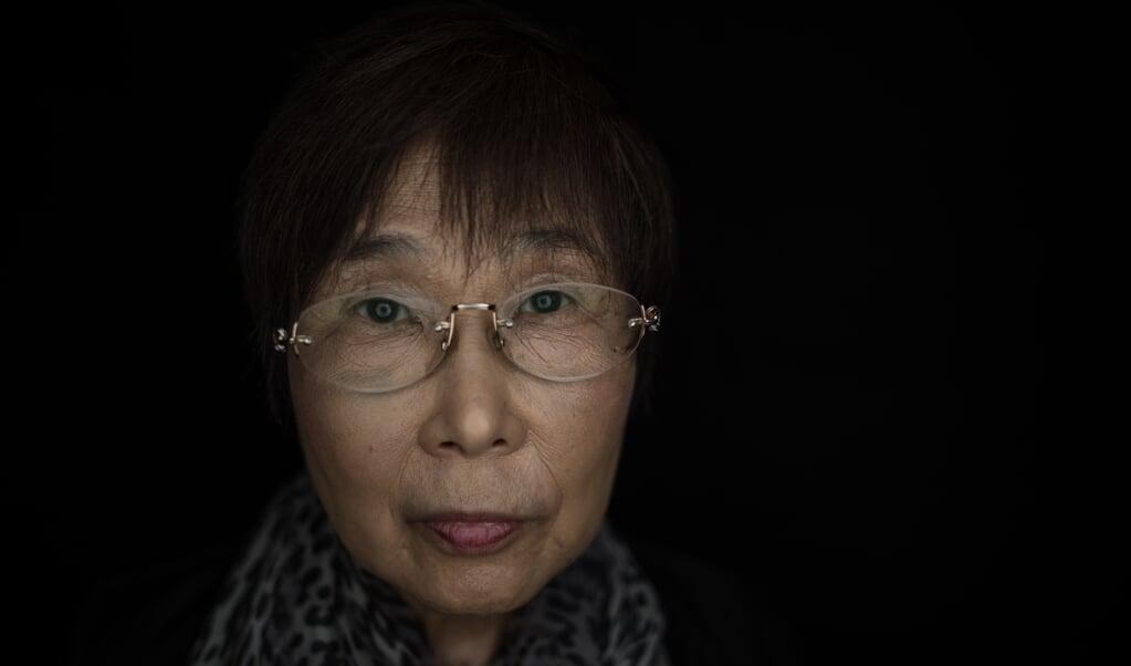 Keiko Ogura, weduwe van de ex-directeur van het Hiroshima-museum, zet zich in om de herinnering aan het bombardement op de stad levend te houden.  (beeld Johannes Eisele / afp)