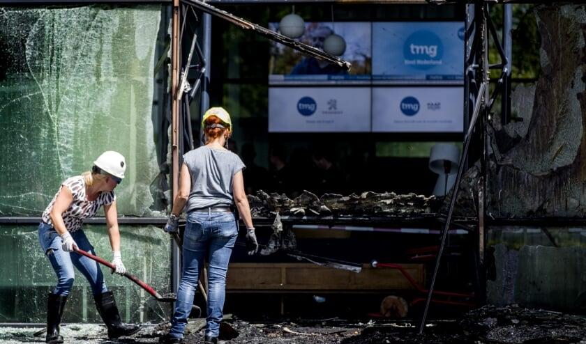 <p>De ravage bij het Telegraafgebouw na de aanslag van 26 juni 2018.</p>  (beeld anp / Koen van Weel)