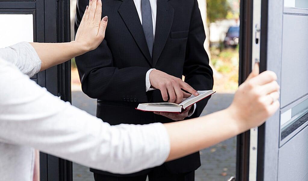 Er zijn mensen die niet opnieuw Jehova's-getuigen aan de deur willen.  (beeld shutterstock)