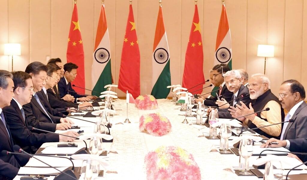 De Indiase premier Narendra Modi en de Chinese president Xi Jinping spraken in 2018 en hier in oktober 2019 af, grensconflicten te de-escaleren. Maar deze maand waren er verschillende botsingen tussen beide landen.  (beeld epa)