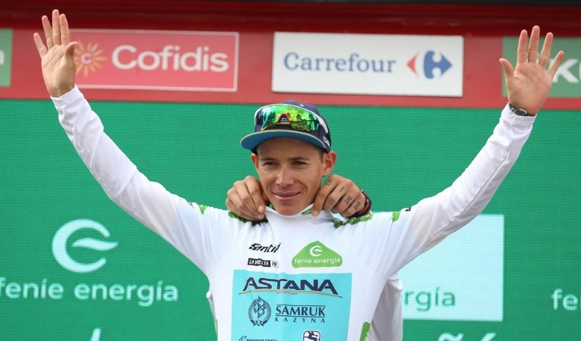 2019-09-12 12:06:23 epa07837823 Colombian rider Miguel Angel Lopez of Astana Pro team celebrates on the podium wearing the best young rider's white jersey after finishing the 18th stage of the Vuelta a Espana cycling race, over 177.5km from Colmenar Viejo  ( beeld anp)