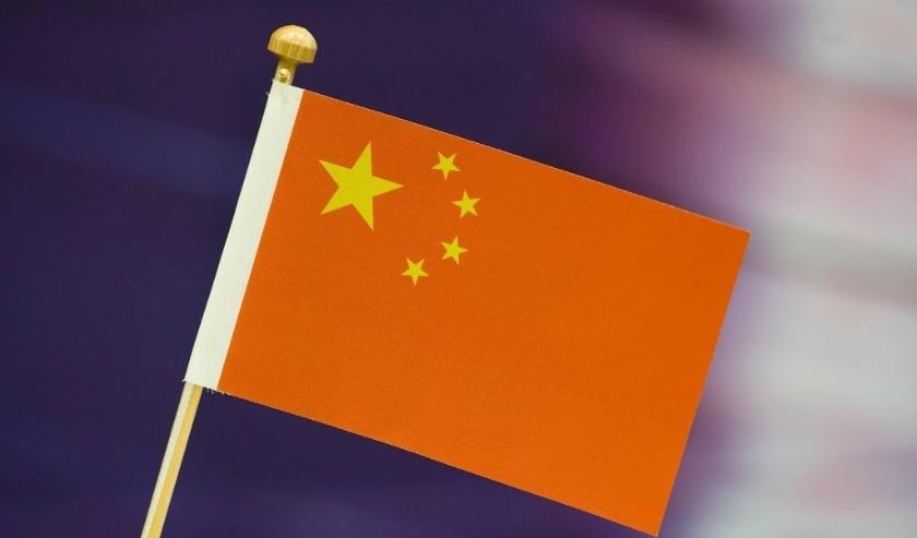 2009-01-17 00:00:00 WIJK AAN ZEE - De Chinese vlag op tafel. In Wijk aan Zee is het grootste en op een na oudste schaaktoernooi van de wereld van start gegaan. Het Corus schaaktoernooi duurt tot en met 1 februari. ANP PHOTO XTRA KOEN SUYK  ( beeld anp)