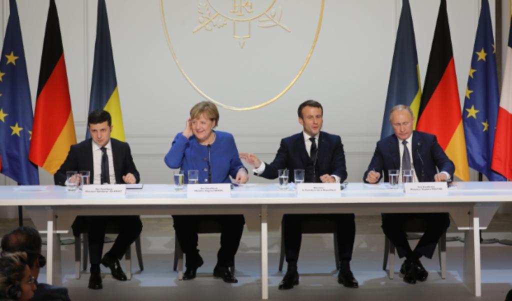 Onder leiding van Frankrijk en Duitsland gingen Rusland en Oekraïne in gesprek.  (afp / Ludovic Marin)
