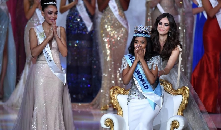 2019-12-14 17:56:01 epa08071862 Miss World 2019, Miss Jamaica Toni-Ann Singh (C) reacts after being crowned during the final in the Excel centre in London, Britain, 14 December 2019. The annual Miss World competition returns to London for its 69th year.    ( beeld anp)