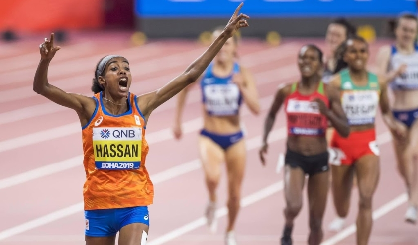 2019-10-05 00:00:00 epa07899255 Sifan Hassan from the Netherlands celebrates winning the women's 1500m final at the IAAF World Athletics Championships 2019 at the Khalifa Stadium in Doha, Qatar, 05 October 2019.  EPA/JEAN-CHRISTOPHE BOTT  ( beeld anp)