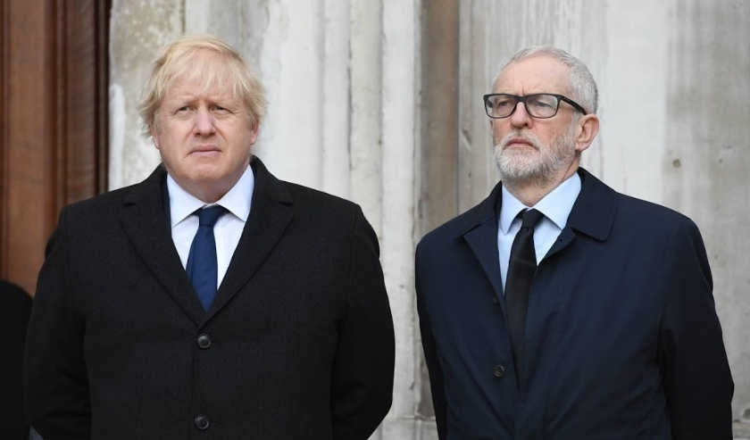 2019-12-02 12:07:23 epa08039207 Britain's Prime Minister Boris Johnson (L) and Labour party leader Jeremy Corbyn (R) take part in a vigil at the Guildhall to pay tribute to the victims of the London Bridge terror attack in London, Britain, 02 December 201  ( beeld anp)