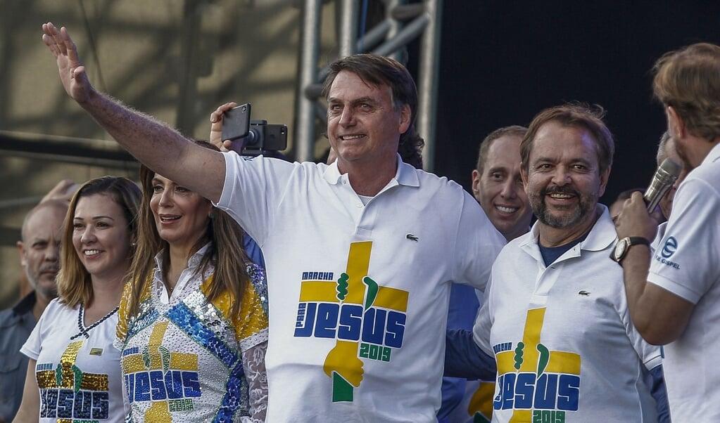 President Jair Bolsonaro van Brazilië tijdens de Mars voor Jezus in São Paulo, in juni vorig jaar.  (beeld afp / Miguel Schincariol)