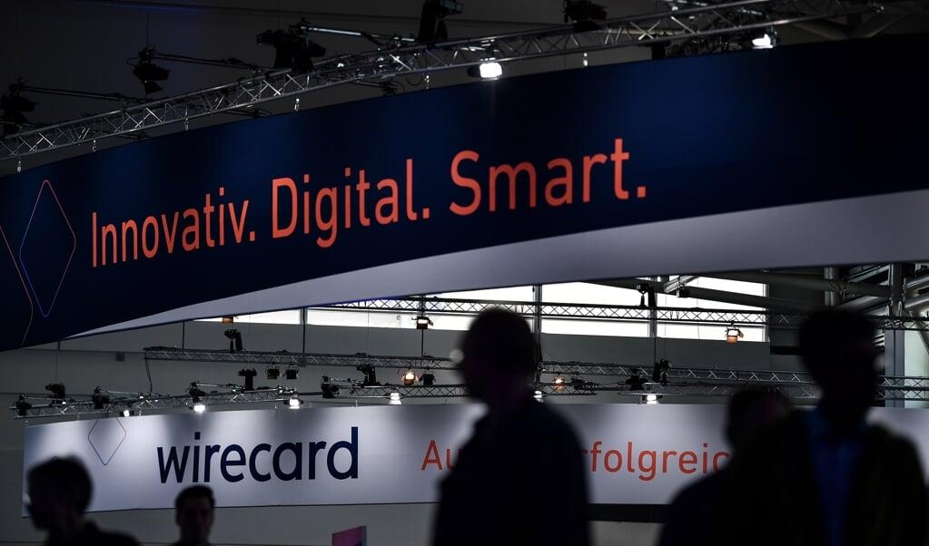 Ronkende teksten op de jaarlijkse aandeelhoudersvergadering van Wirecard in München, in juni vorig jaar.  (beeld epa / Philipp Guelland)