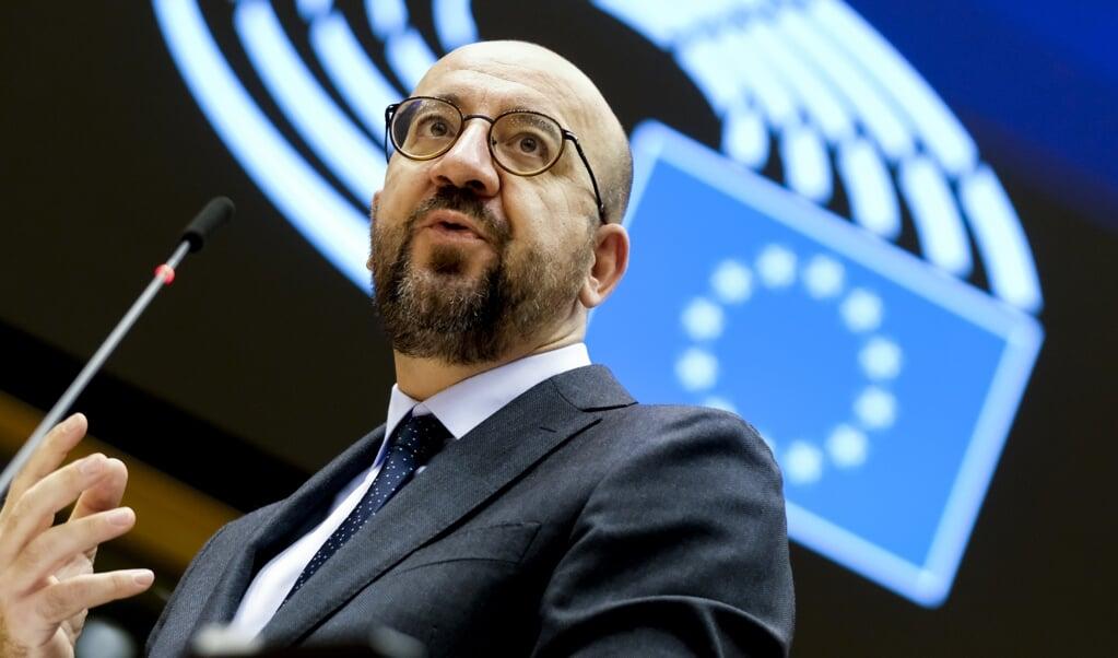 <p>EU-president Charles Michel: handen ineenslaan om pandemie te verslaan.</p>  (beeld afp / Olivier Hoslet)