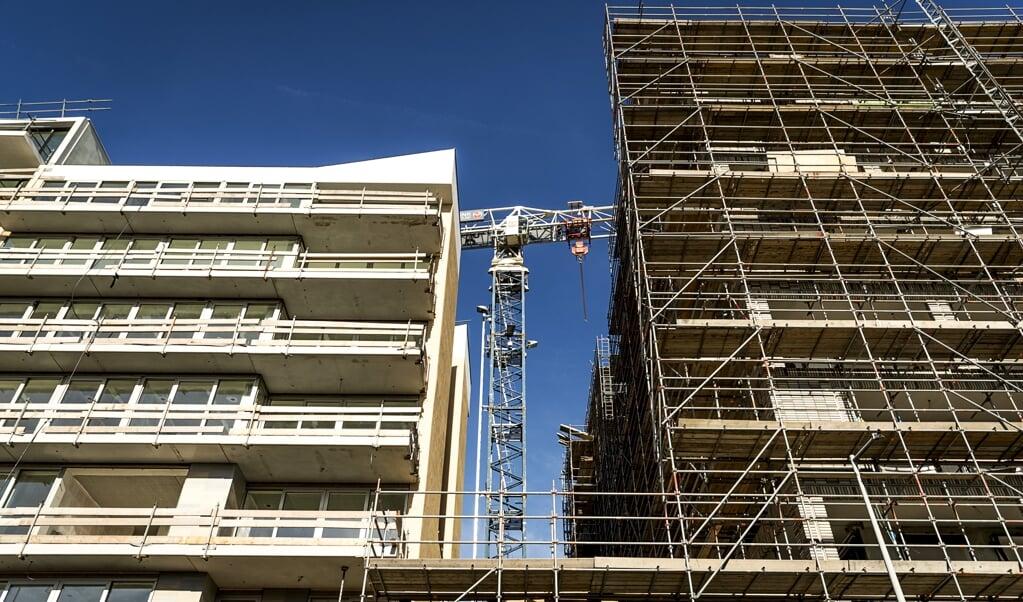 <p>Een bouwproject in Buiksloterham, Amsterdam-Noord.</p>  (beeld anp / Remko de Waal)