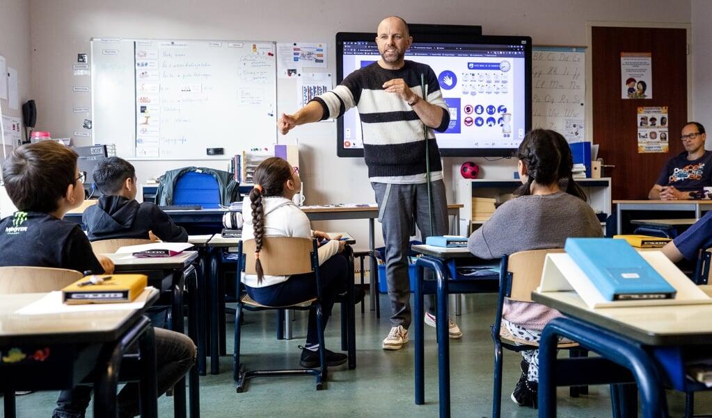 'In de klas hoort iedereen erbij.' (archieffoto)  (beeld anp / sem van der wal)