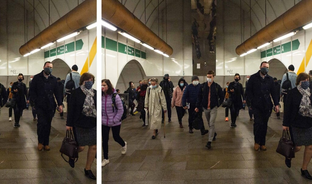 Passengers wearing face masks walk in the corridor of a metro station on October 13, 2020 in Prague.  After a recent spike in infections, the Czech government announced on October 12, 2020 that new measures against the new coronavirus COVID-19 pandemic include the closure of pubs and restaurants and the lower grades of primary schools, implementation of mask-wearing rules, and a ban on public alcohol consumption starting October 14, 2020. Michal Cizek / AFP  ( beeld epa / MICHAL CIZEK )