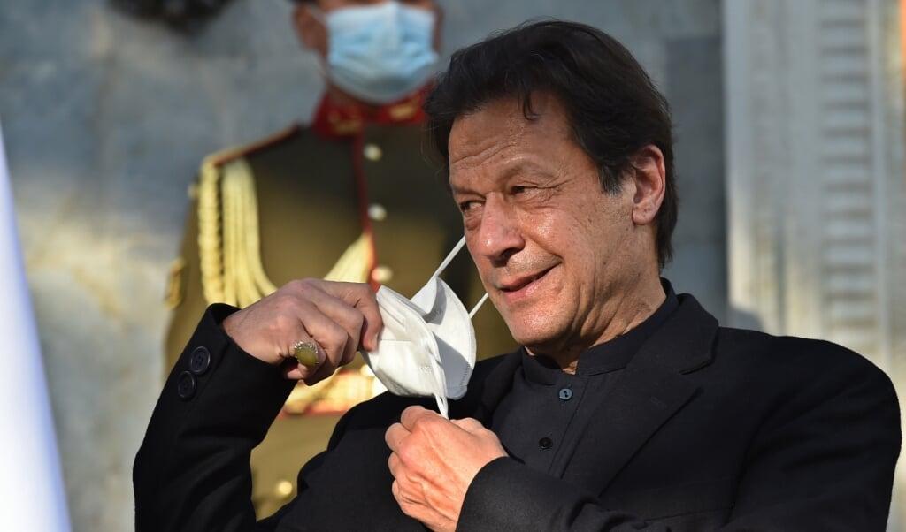 'Kinderen zijn het meest kostbare bezit van iedere natie en de enige garantie voor de toekomst', aldus de Pakistaanse premier Imran Khan afgelopen vrijdag. Maar wat hij zegt, is loos gebazel.   (beeld Wakil Kohsar / afp)