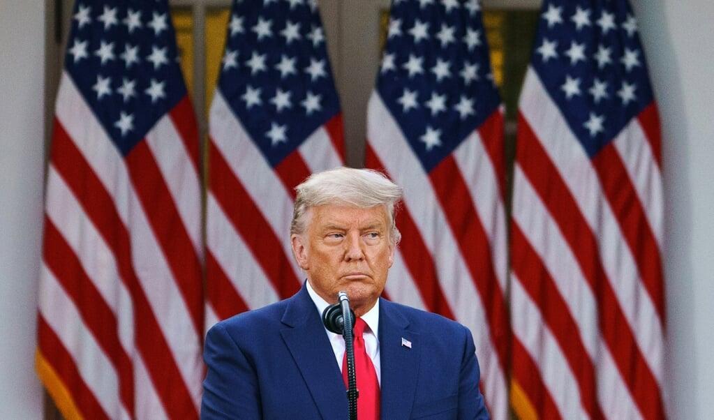 Donald Trump: 'Ik geef NIETS toe!'  (beeld afp / Mandel Ngan)