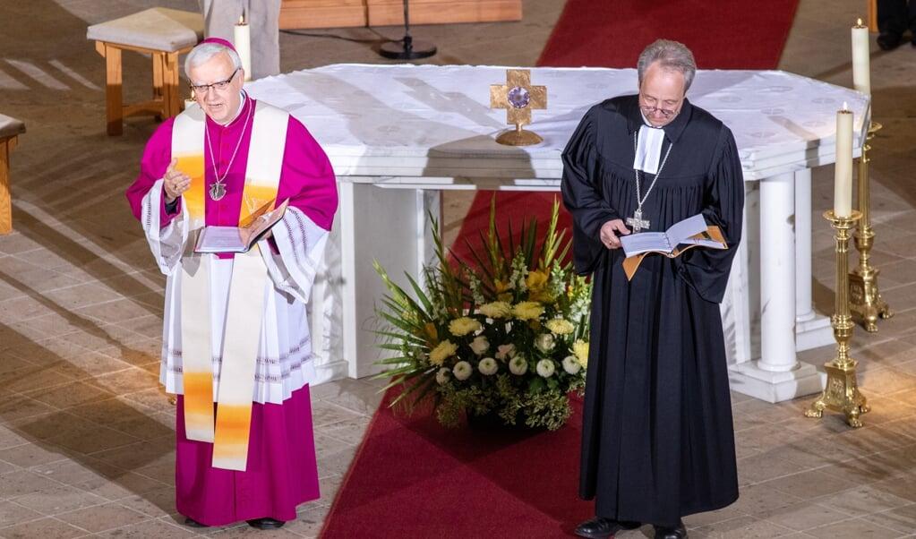 Een oecumenische gebedsdienst in Potsdam op 3 oktober 2020.  (beeld Epa/andreas Gora )