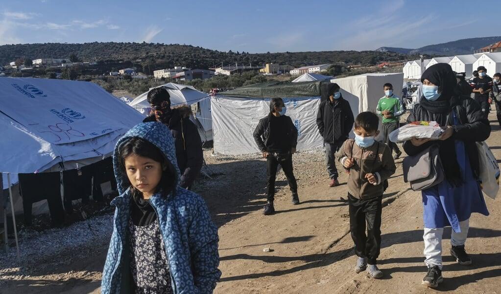 Migranten in het kamp op Lesbos.  (beeld afp / Anthi Pazianou)