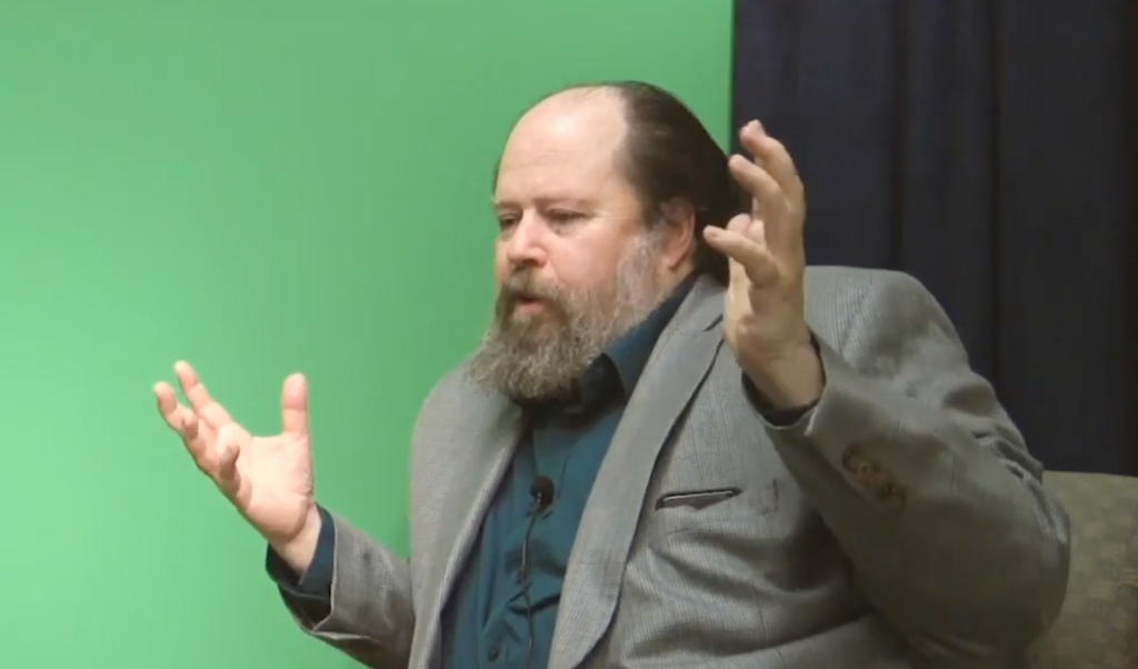 Theoloog David Bentley Hart tijdens een interview in 2019.  (beeld youtube)