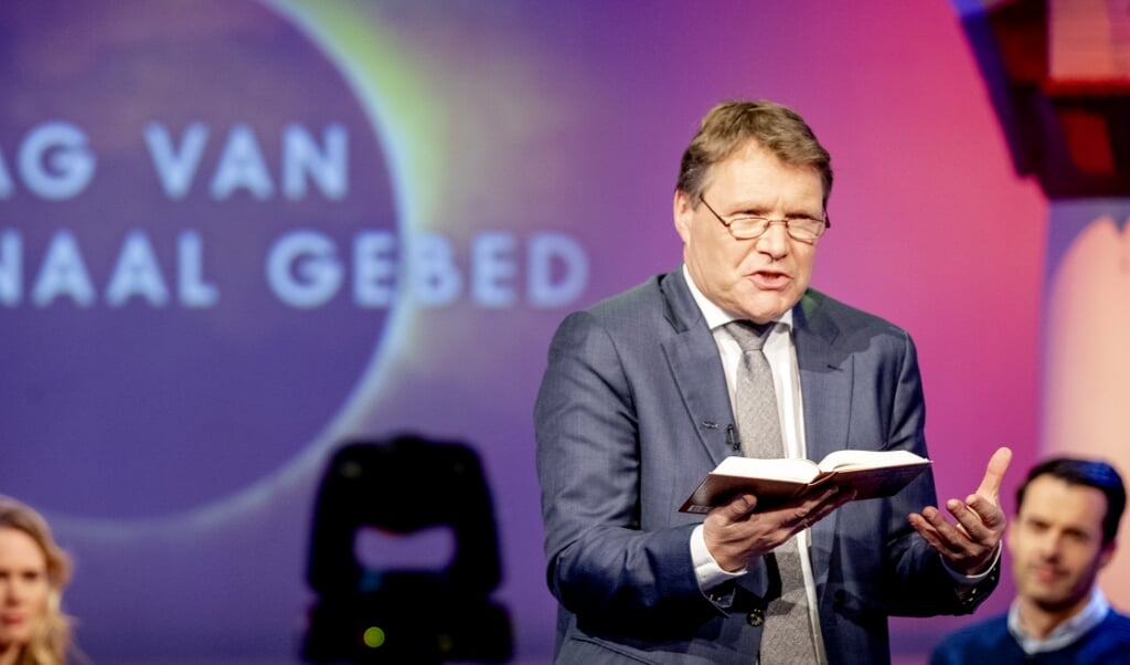 <p>PKN-scriba René de Reuver tijdens de Dag van het Nationaal Gebed in maart.</p>  (beeld anp / Sem van der Wal)