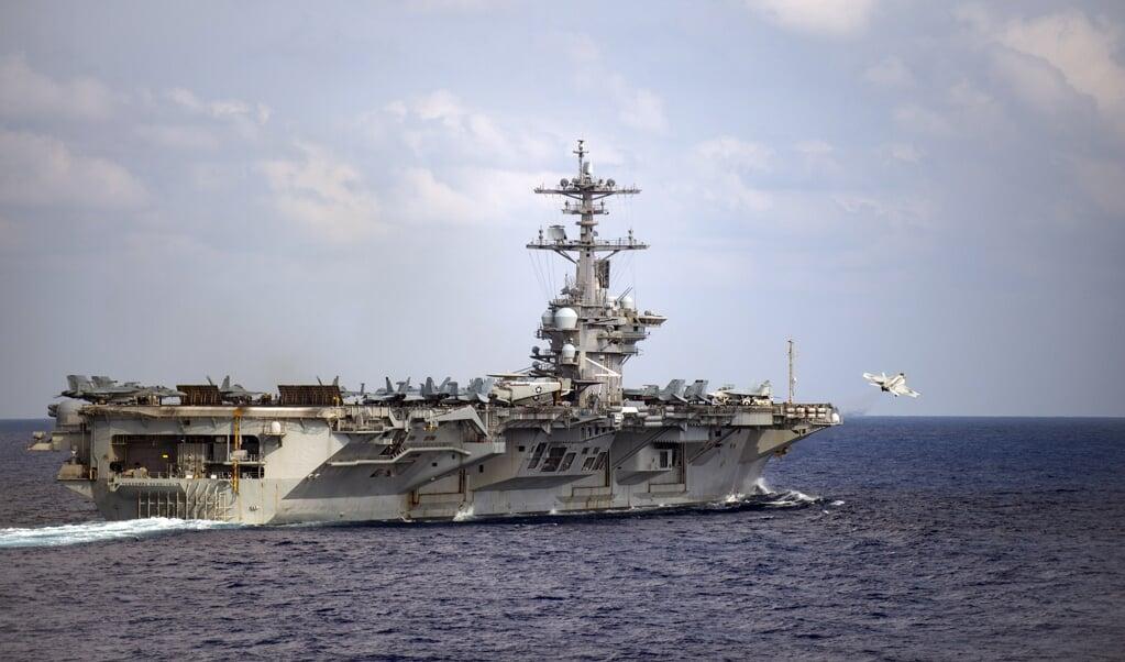 Het nucleaire vliegdekschip USS Theodore Roosevelt heeft te maken met een snel oplopend aantal coronabesmettingen.  (beeld afp / Nicholas v. Huynh)
