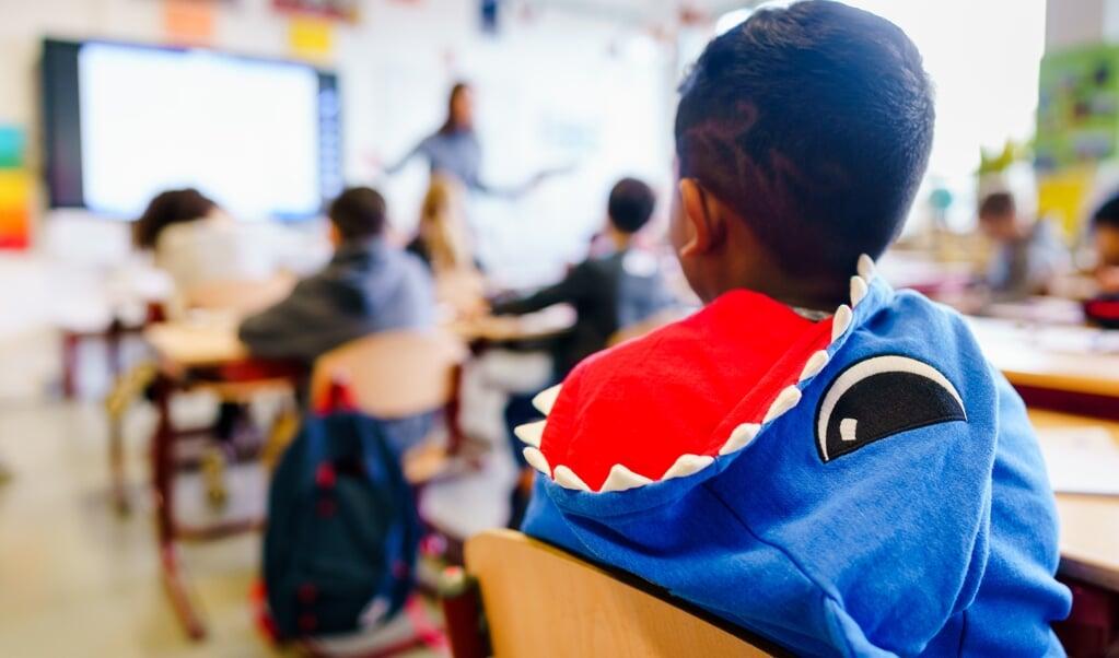 Geen school, veel zieke mensen en onzekerheid. Hoe praat je nu met kinderen over God?   (beeld anp / Marco de Swart)