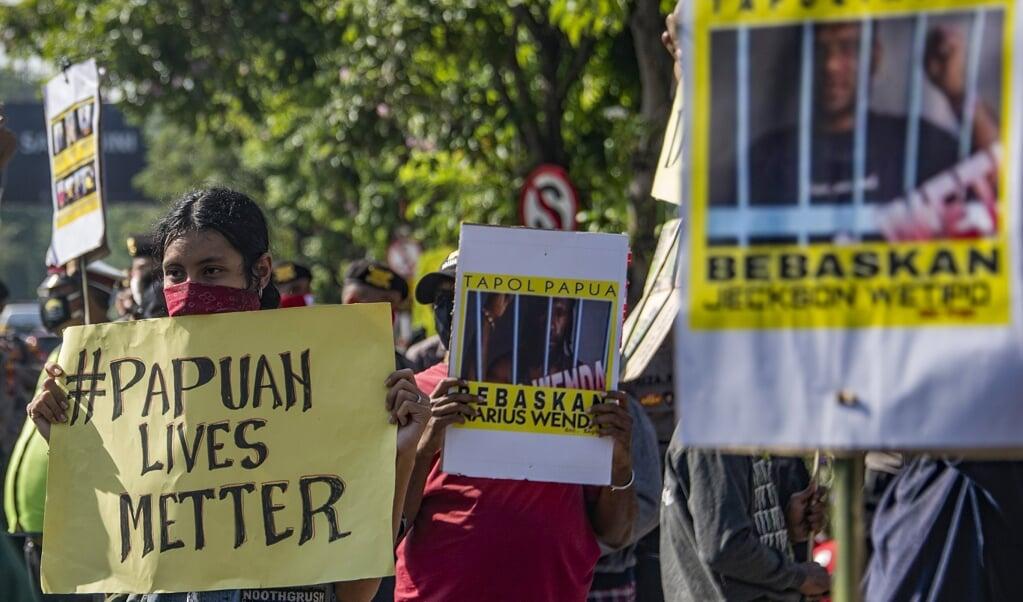 Afgelopen maand riepen Papoease studenten in Java Indonesië op demonstranten vrij te laten.  (beeld Juni Kriswanto / afp)