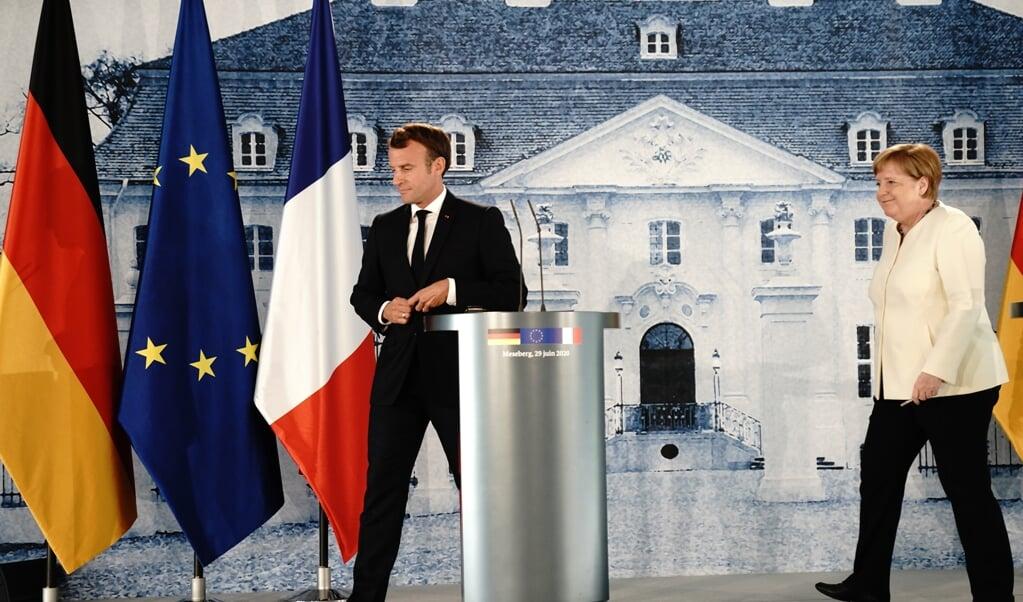Macron spreekt graag beeldend en met grote woorden. Merkel is saai, technocratisch, maar uiteindelijk solide en effectief.  (beeld Kay Nietfeld / afp)