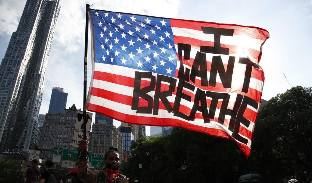 Protest tegen de arrestatie van George Floyd.  (beeld epa / Jason Szenes)