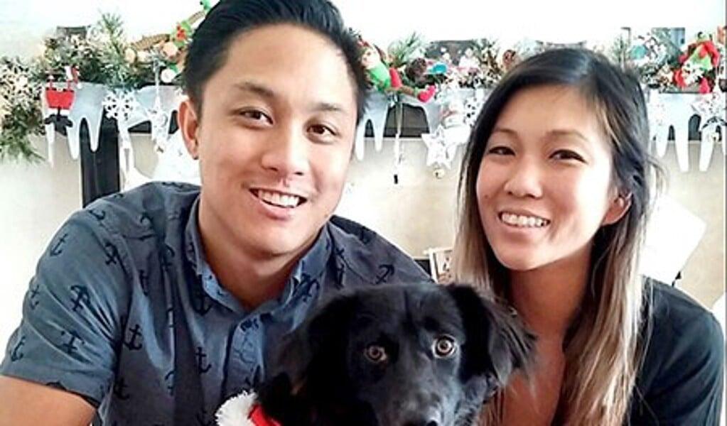 Een van de onderzoekers, Tina Wang (rechts), en haar echtgenoot Branden met hond Belli, die een inspiratiebron was voor het onderzoek.  (beeld )