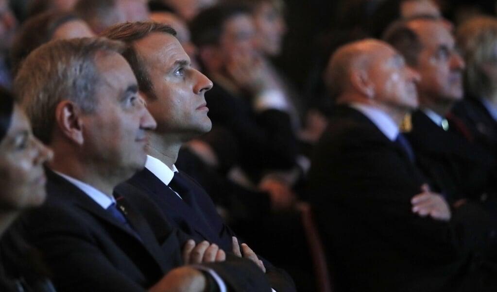 Tijdens '500 jaar Reformatie' in 2017 zaten de Franse president Emmanuel Macron en  François Clavairoly, vertegenwoordiger van protestants Frankrijk, gebroederlijk naast elkaar.  (beeld afp / Gonzalo Fuentes)