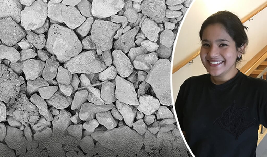 Madumita Sadagopan met stukken betonafval.  (beeld Universiteit van Borås)