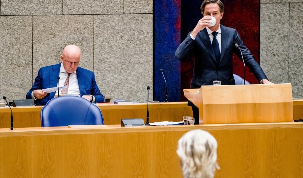 Grapperhaus en Rutte in debat met PVV-leider Wilders over de avondklok.   (beeld anp / Bart Maat)