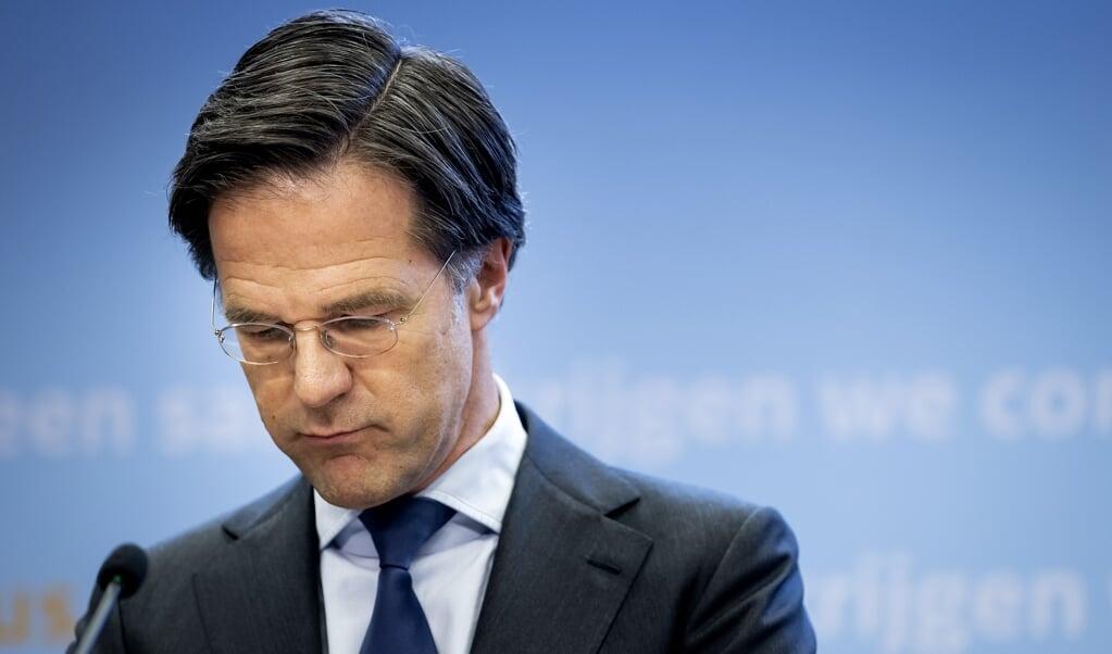 Minister-president Mark Rutte tijdens een persconferentie over de coronamaatregelen.  (beeld anp / Sem van der Wal)