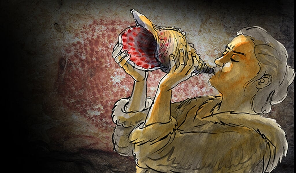 Reconstructie van een prehistorische muzikant die in de grot op de schelp blaast.   (beeld Gilles Tosello)