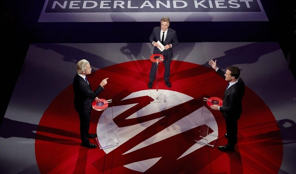 PVV-fractievoorzitter Geert Wilders en Mark Rutte tijdens een debat in 2017.  (beeld anp / Martijn Beekman)