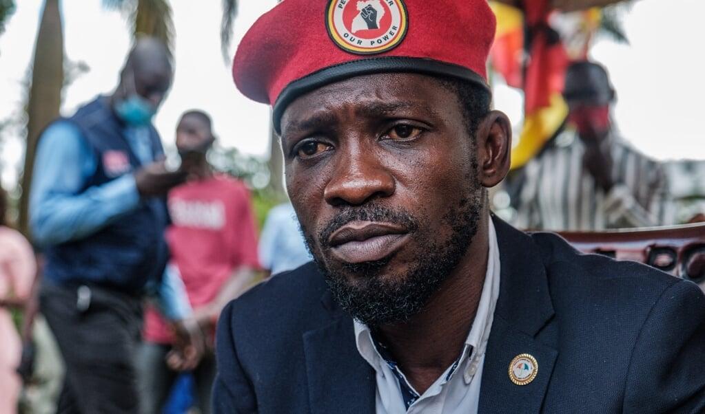 Oppositieleider Bobi Wine.  (beeld afp)