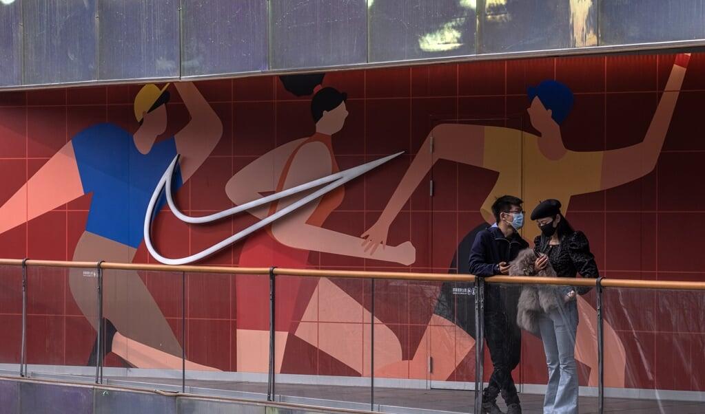 Onder andere Nike en Adidas worden in China met een 'consumentenboycot' geconfronteerd.  (beeld epa / Roman Pilipey)