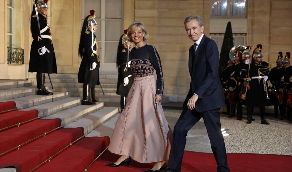 Bernard Arnault en zijn vrouw Helene Mercier-Arnault in 2019  (beeld afp / Ludovic Marin)