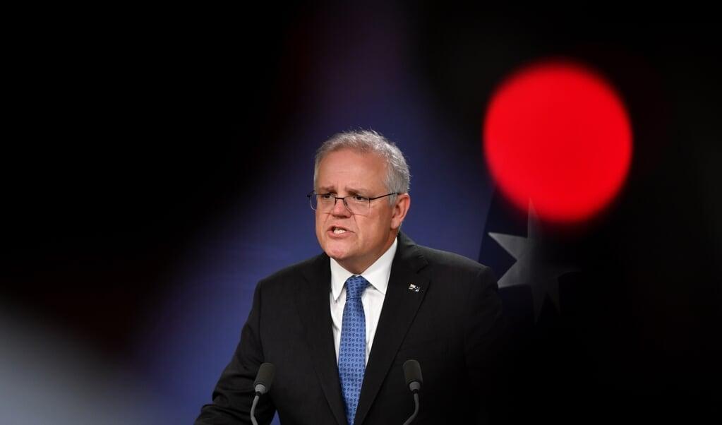 De Australische minister-president Scott Morrison.  (beeld epa / Joel Carrett)