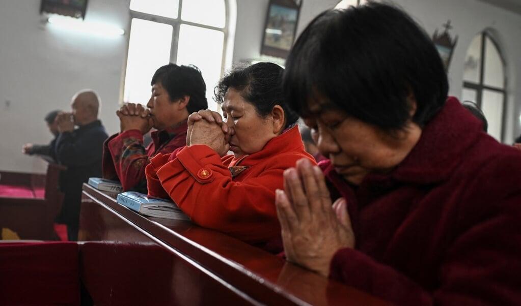 Het rapport toont dat geloofsvervolging toeneemt in China.   (beeld afp / Jade Gao)
