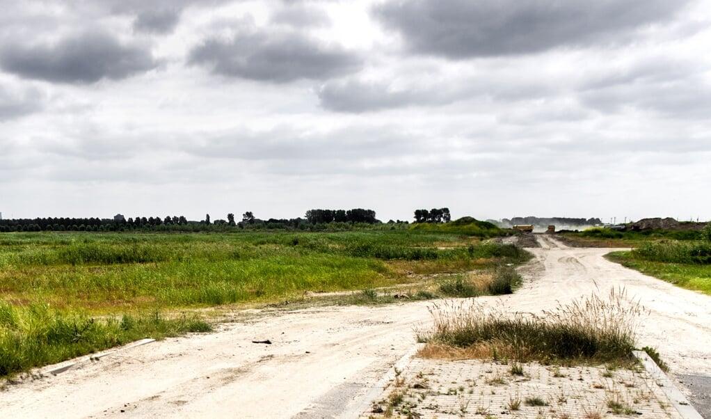 Iedereen is het erover eens dat Nederland meer woningen nodig heeft, maar de politieke partijen verschillen van mening over de vraag waar die woningen gebouwd moeten worden.  (beeld anp / Koen van Weel)