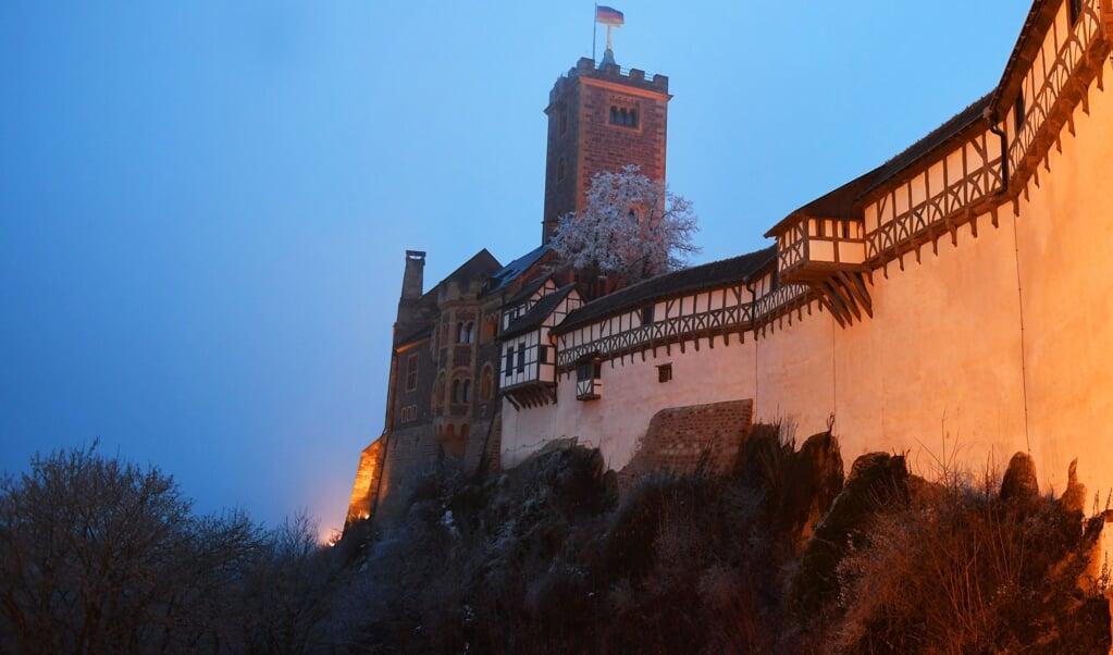 De Wartburg in Eisenach, waar reformator Maarten Luther bijna een jaar verbleef.  (beeld afp / Jens Kalaene)