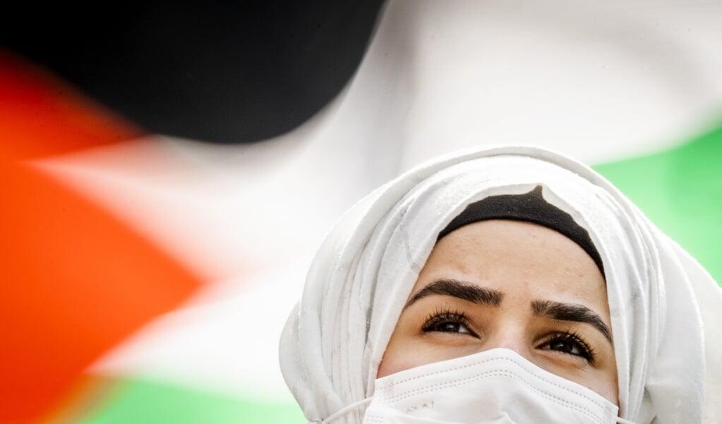 Een vandaag gehouden protest voor de bevrijding van Palestina op het Jaarbeursplein. De actie is bedoeld om solidariteit met de Palestijnse bevolking te tonen. ANP REMKO DE WAAL  (beeld anp / Remko de Waal)
