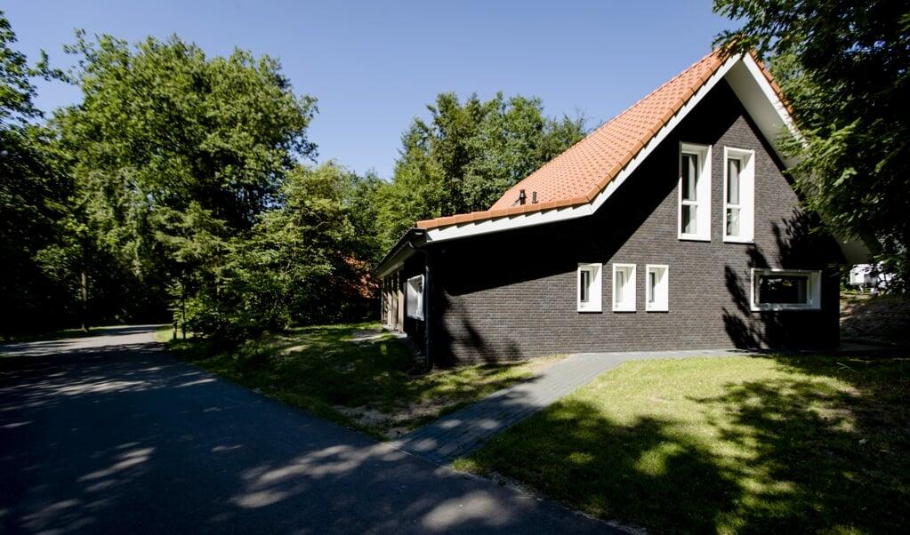 Parken met tweede woningen - zoals deze op de Veluwe - worden uit de grond gestampt, terwijl de nood om éérste woningen hoog is.  (beeld anp / Robin van Lonkhuijsen)