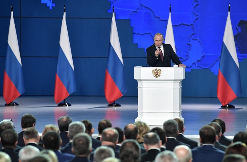 President Putin woensdag tijdens zijn jaarlijkse rede voor het parlement.  (epa / Alexey Nikolsky)