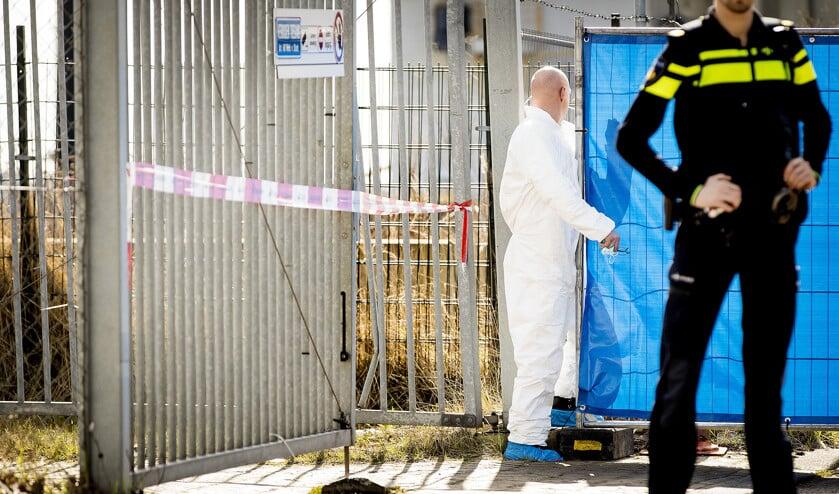 Politieonderzoek na de moord op de 41-jarige Reduan B. op de Tt. Melissaweg in Amsterdam in maart 2018.  (epa)
