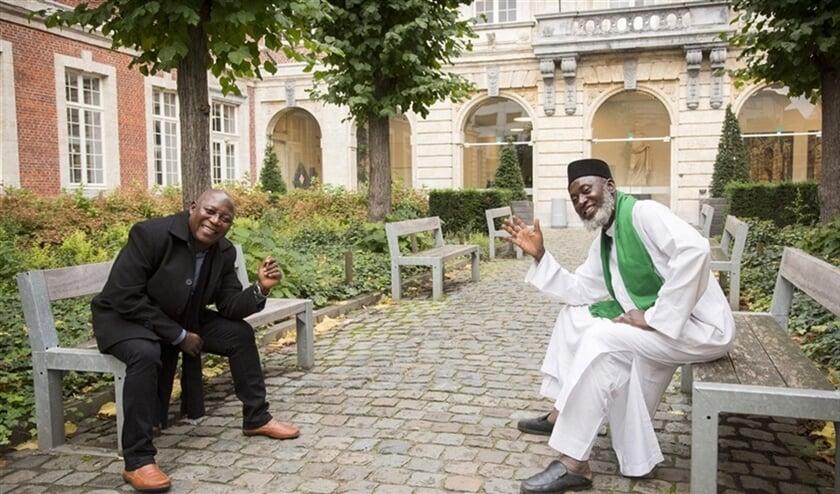 Voorganger James Wuye (l.) en imam Muhammad Ashafa zeggen dat hun doel is 'mensen te leren de ander te accepteren. We delen onze menselijkheid en hebben gedeelde belangen.'  (Michael de Lausnay)