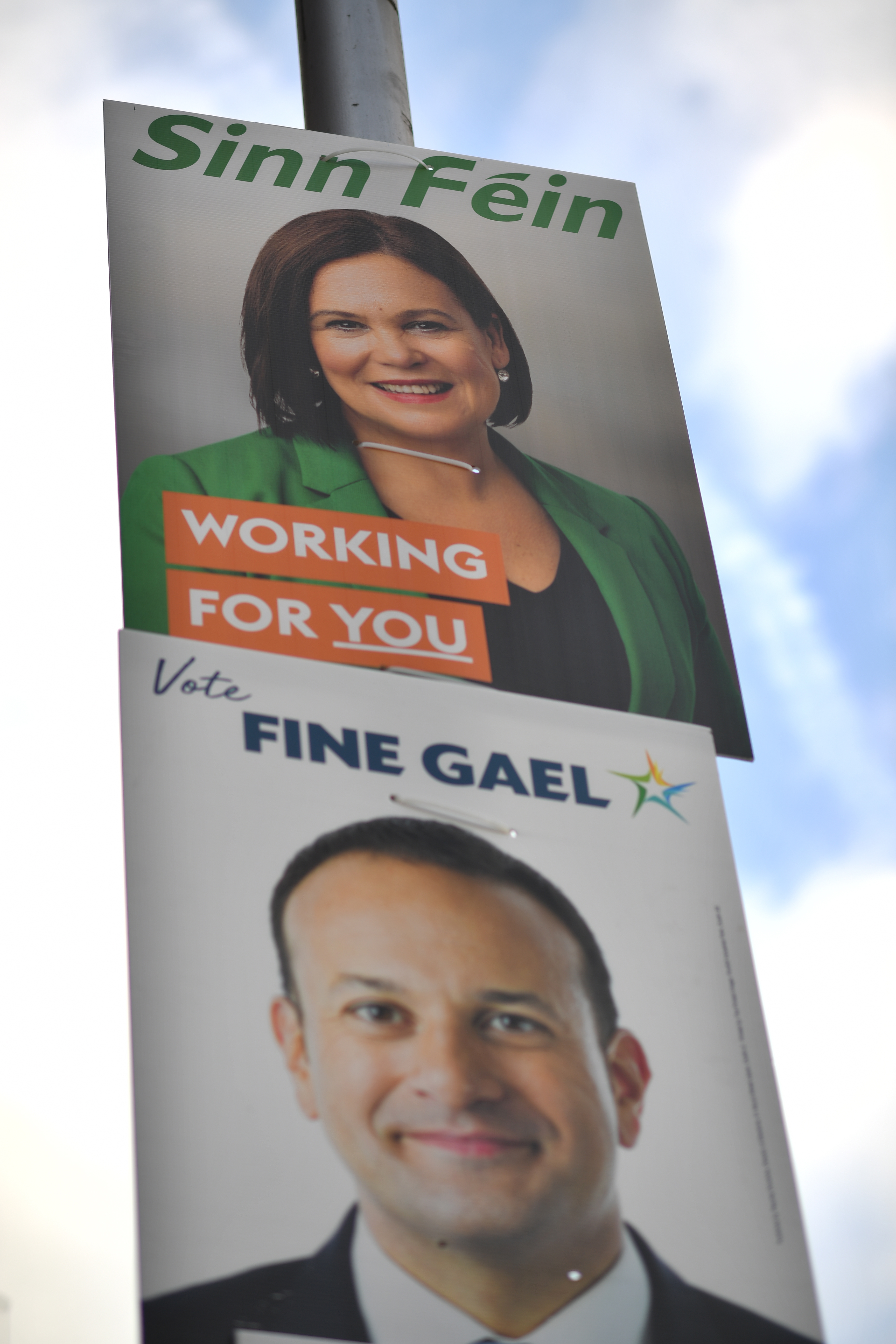 2020-02-06 14:22:22 Election posters featuring Sinn Fein President Mary Lou McDonald (top) and Ireland's Prime minister and Fine Gael leader Leo Varadkar are pictured on Grattan Bridge in Dublin on February 6, 2020, ahead of the February 8 General Election.  Ireland will go to the polls on Fenruary 8, in an early general election, Prime Minister Leo Varadkar said, seeking to capitalise on his part in brokering the Brexit deal. Ben STANSALL / AFP
